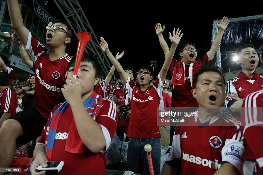South China fans celebrate during the Barclays Asia Trophy Semi Final match between Manchester City and South China at Hong Kong Stadium on July 24...