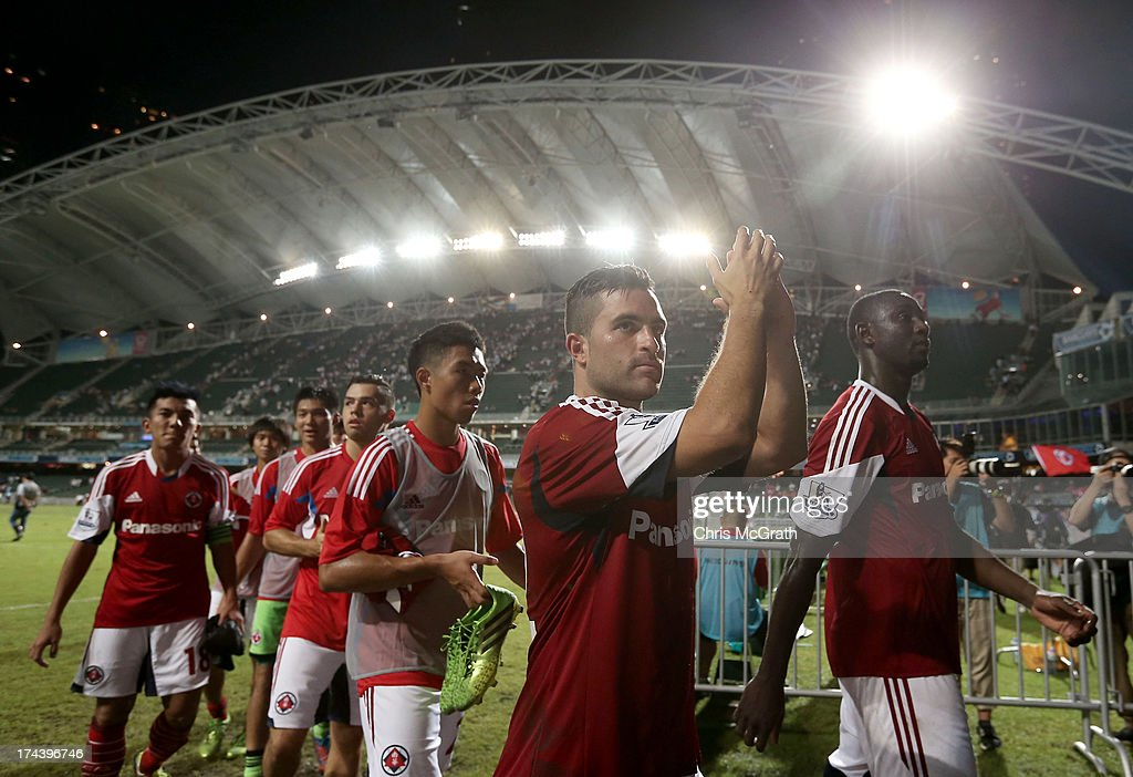 South China players wave to the crowd after the Barclays Asia Trophy Semi Final match between Manchester City and South China at Hong Kong Stadium on July 24, 2013 in So Kon Po, Hong Kong.