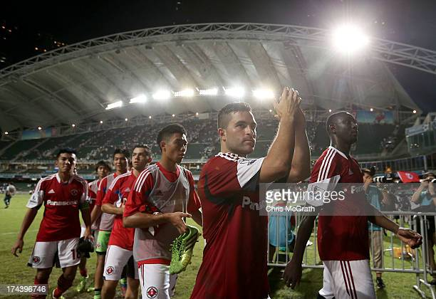South China players wave to the crowd after the Barclays Asia Trophy Semi Final match between Manchester City and South China at Hong Kong Stadium on...
