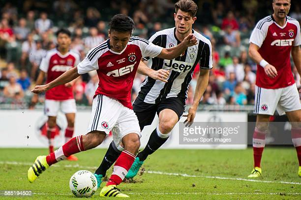 South China's player Chak Ting Fung contests the ball against Juventus' player Alberto Cerri during the South China vs Juventus match of the AET...