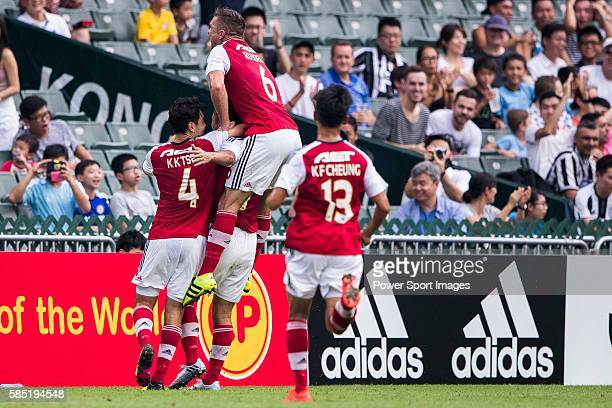South China's players celebrate after South China's player Chan Siu Ki's scoring the first score at the South China vs Juventus match of the AET...