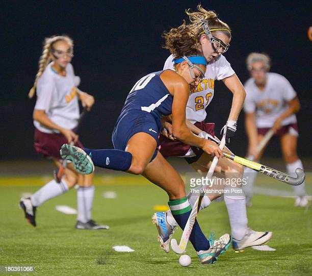 South County's Isabel Josephs center collides with Oakton's Jackie Toye center right in front of Oaktons goal during the South County Stallions...