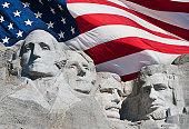 USA, South Dakota, Mount Rushmore National Memorial and American flag