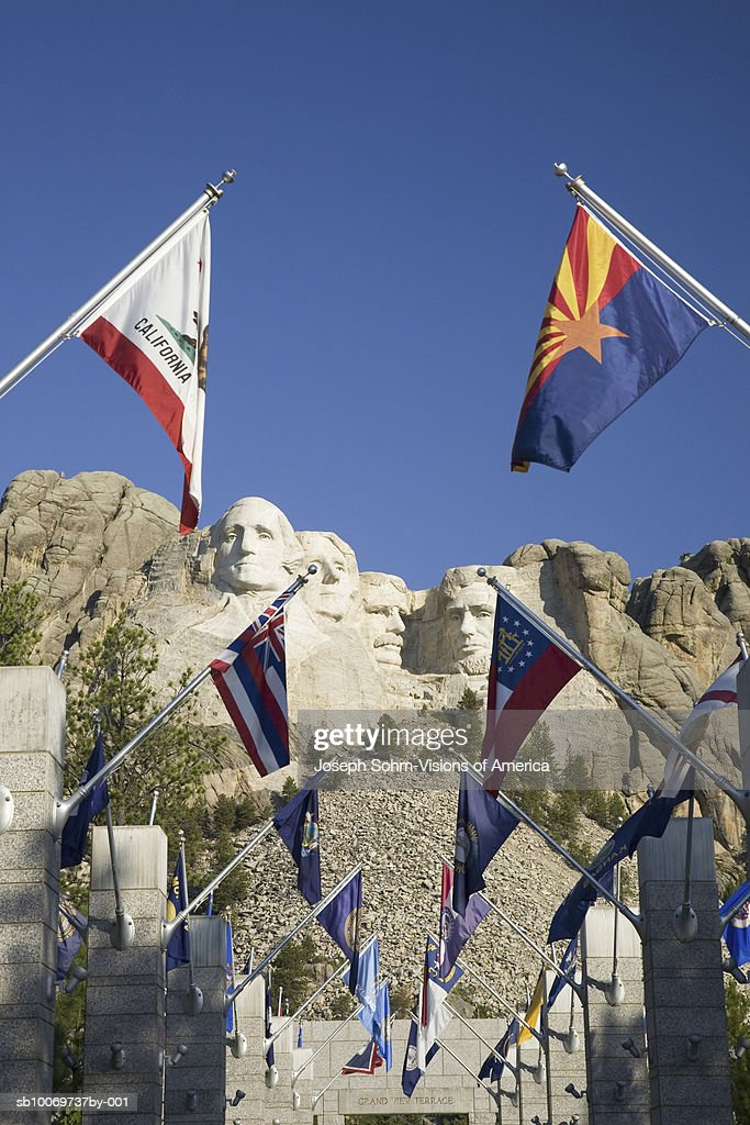 USA, South Dakota, Mount Rushmore National Memorial, state flags lining walkway : Stock Photo