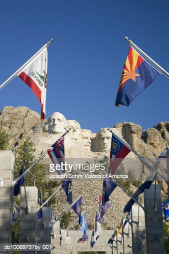USA, South Dakota, Mount Rushmore National Memorial, state flags lining walkway : Stock Photo