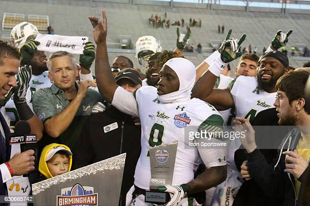 South Florida Bulls quarterback Quinton Flowers receives his MVP trophy after the Birmingham Bowl between the South Carolina Gamecocks and the South...