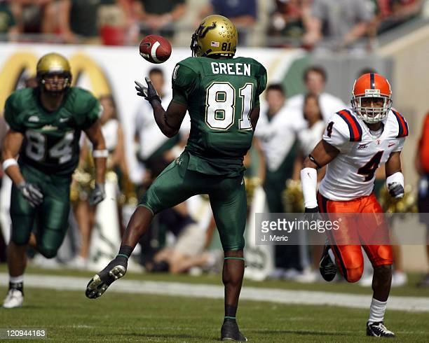 South Florida receiver SJ Green hauls in a pass as Syracuse cornerback Terrell Lemon closes in during Saturday's action at Raymond James Stadium in...