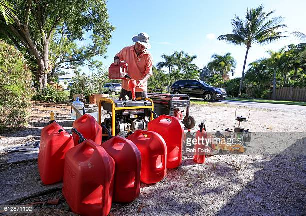 South Florida resident James Balboni puts gas in a generator in preparation for Hurricane Matthew on October 5 2016 in Fort Lauderdale Florida The...
