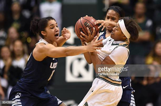 South Florida's Shalethia Stringfield riight is defended by Connecticut's Gabby Williams left and Morgan Tuck at the USF Sun Dome in Tampa Fla on...
