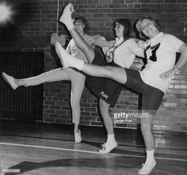 South High School Pompon Girl Shows Two Candidates How Kick Is Done Mary Millard center shows the kick to candidates Pam Patrick of 860 Cove Way left...