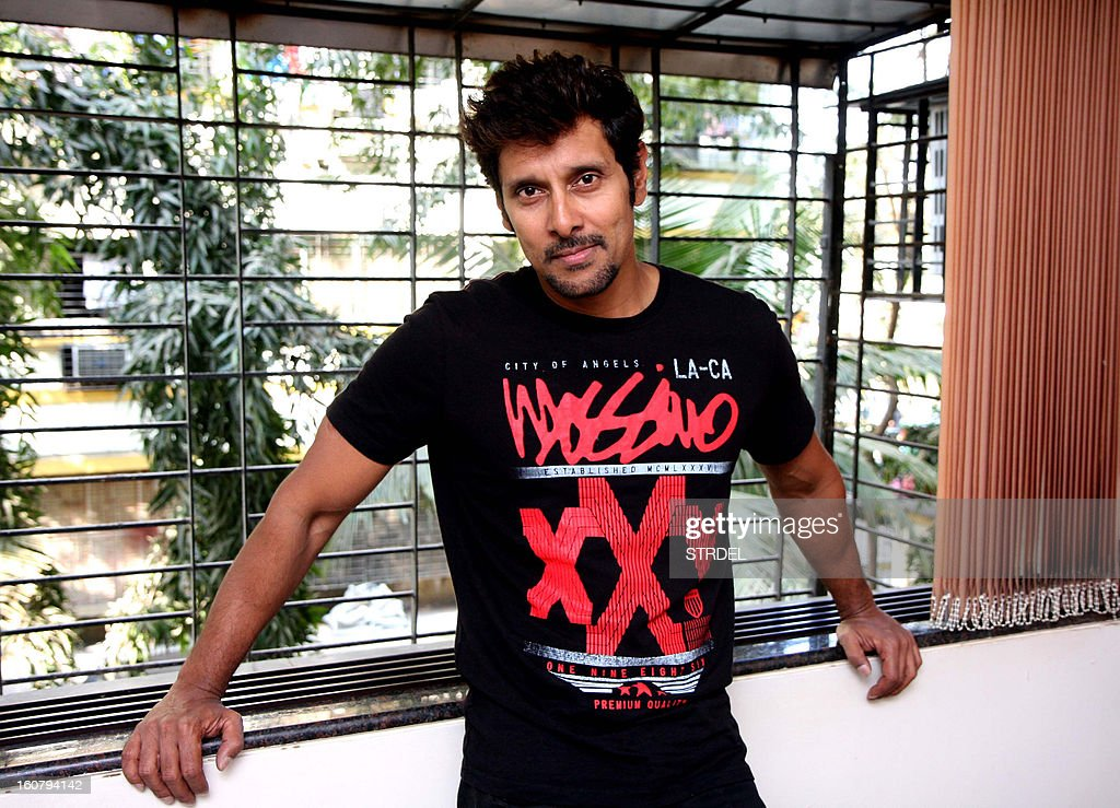 South Indian actor Vikram poses during a press meet in Mumbai on February 5, 2013.