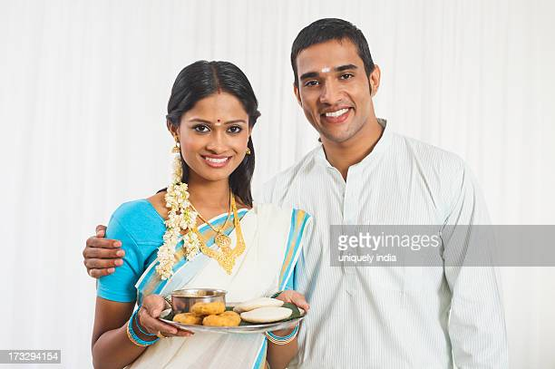 South Indian couple with food