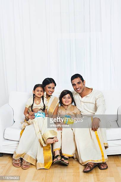 South Indian family holding gifts at Onam