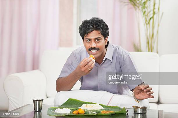 South Indian man having food