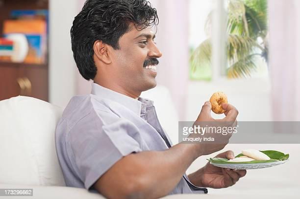 South Indian man having vada