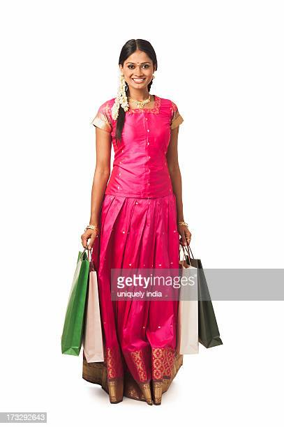 South Indian woman carrying shopping bags