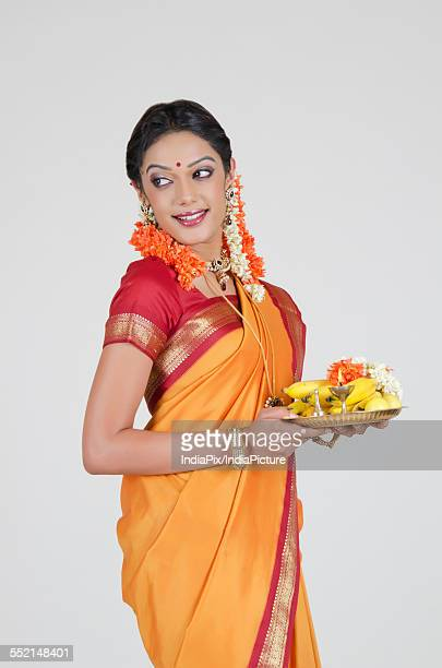 South Indian woman holding a thali