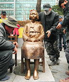 SEOUL South Korea A statue of a seated young Korean girl in traditional costume is set up in front of the Japanese Embassy in Seoul on Dec 14 by a...