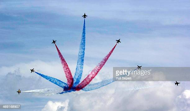 South Korea Air Force Black Eagles aerobatic team performs during the Singapore Airshow on February 13 2014 in Singapore The Singapore air show is...