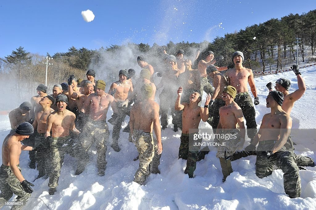 South Korea and US Marines hurl snow during a joint winter drill in Pyeongchang, some 180 kilometers east of Seoul, on February 7, 2013. Marines from South Korea and the United States took part in a military winter drills, which began on February 4 and run through February 22, to test their limits in extreme conditions.