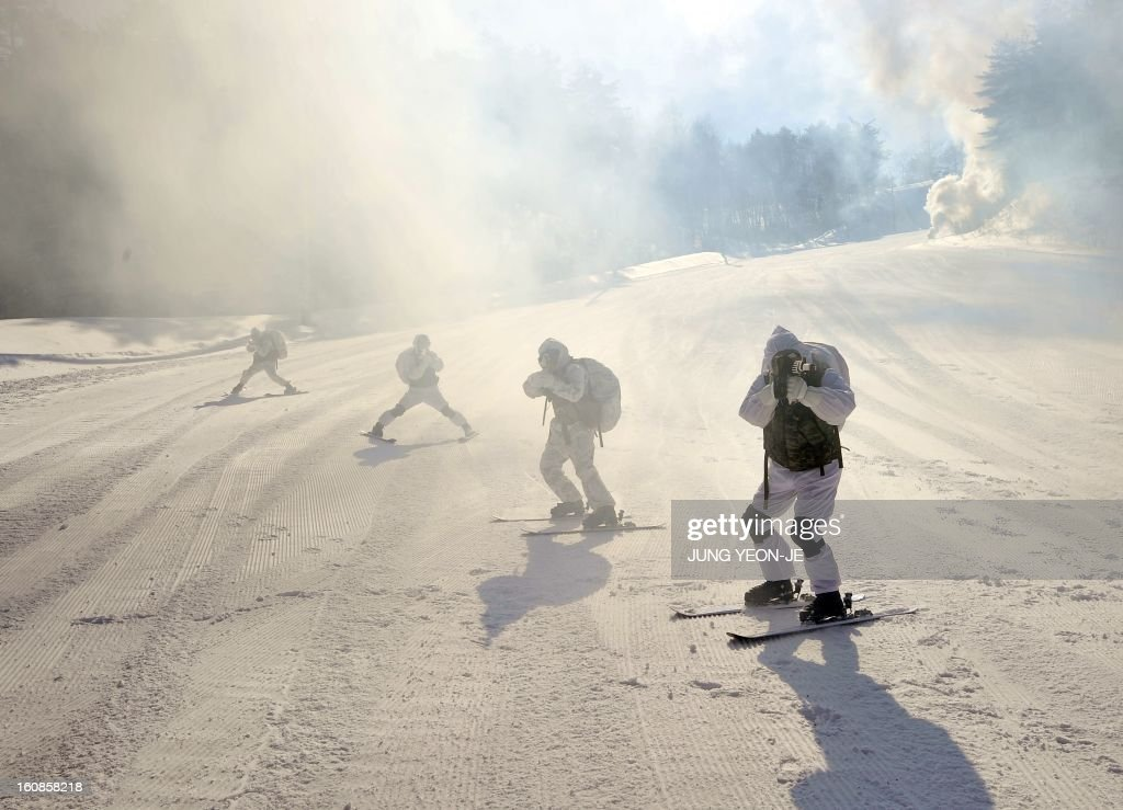 South Korea and US Marines take aim as they ski down a hill during a joint winter drill in Pyeongchang, some 180 kilometers east of Seoul, on February 7, 2013. Marines from South Korea and the United States took part in a military winter drills, which began on February 4 and run through February 22, to test their limits in extreme conditions.