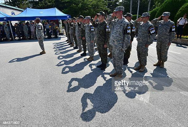 South Korea and US soldiers salute during a remembrance ceremony of the 1976 'Axe Murder Incident' at the Camp Bonifas near the border village of...