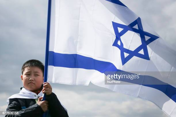 South Korea boy holds a flag of Israel during the 'March of the Living' at the former NaziGerman Auschwitz Birkenau concentration and extermination...