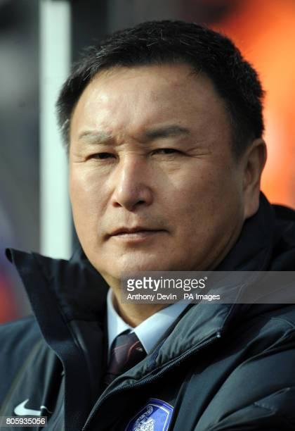 South Korea coach Huh JungMoo looks onduring the International Friendly at Loftus Road London