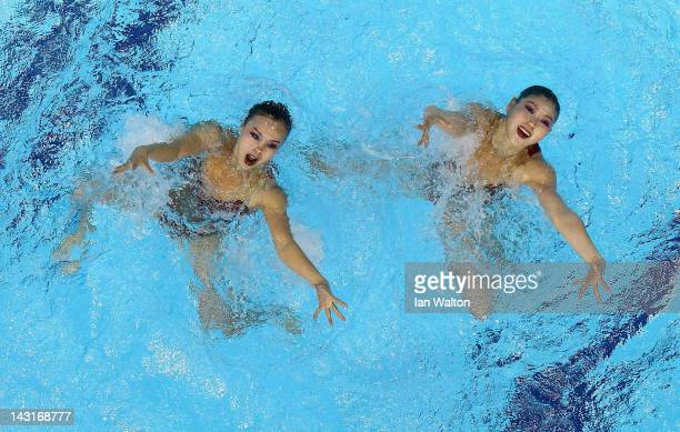 South Korea compete in the Duets Freel routine during the FINA Olympic Games Synchronised Swimming Qualification event at the London Aquatics Centre...