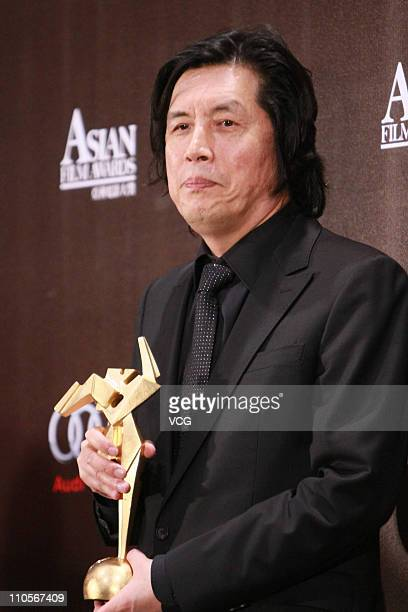 South Korea director Lee Changdong poses with the trophy at the 5th Asian Film Awards at the Hong Kong Convention and Exhibition Center on March 21...
