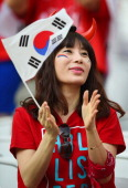 South Korea fan enjoys the atmosphere prior to kickoff during the 2014 FIFA World Cup Brazil Group H match between South Korea and Belgium at Arena...