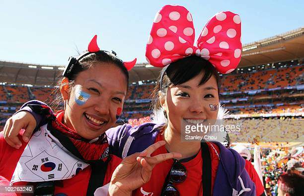 South Korea fans pose ahead of the 2010 FIFA World Cup South Africa Group B match between Argentina and South Korea at Soccer City Stadium on June 17...