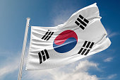 South Korea flag is waving at a beautiful and peaceful sky in day time while sun is shining. 3D Rendering
