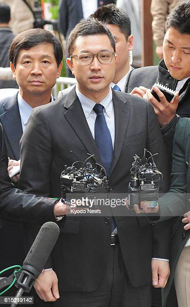 SEOUL South Korea Lee Shi Hyung the son of South Korean President Lee Myung Bak makes his way to undergo questioning by South Korea's independent...