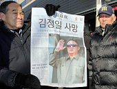 SEOUL South Korea Members of a conservative group hold a special edition of a newspaper reporting the death of North Korean leader Kim Jong Il in...