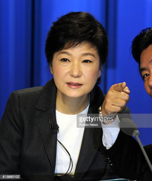 SEOUL South Korea Park Geun Hye a South Korean presidential candidate from the ruling Saenuri Party gets ready for a televised debate with two other...