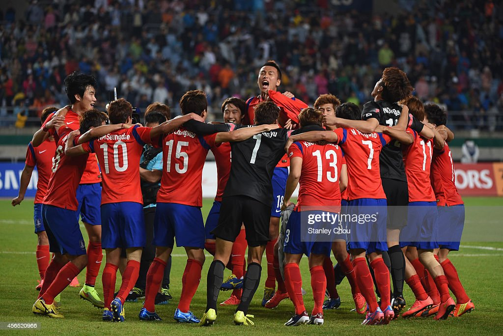 South Korea players celebrate the 1-0 win and gold medal after the Football Men's Gold Medal match between South Korea and North Korea during day thirteen of the 2014 Asian Games at Munhak Stadium on October 2, 2014 in Incheon, South Korea.