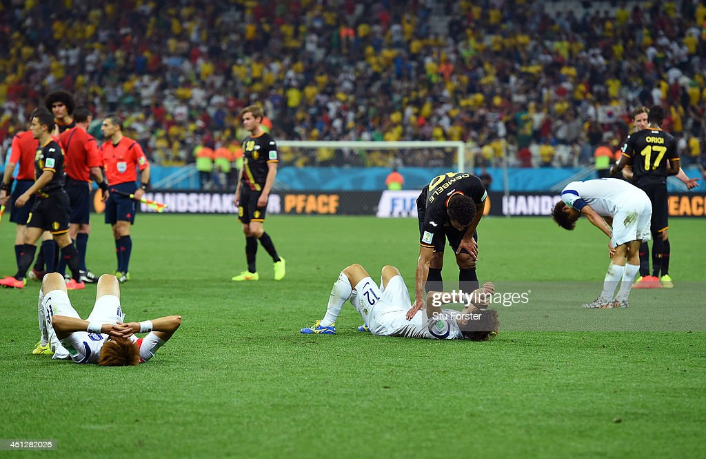 South Korea players look dejected after a 0-1 defeat to Belgium in the 2014 FIFA World Cup Brazil Group H match between South Korea and Belgium at Arena de Sao Paulo on June 26, 2014 in Sao Paulo, Brazil.