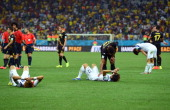 South Korea players look dejected after a 01 defeat to Belgium in the 2014 FIFA World Cup Brazil Group H match between South Korea and Belgium at...