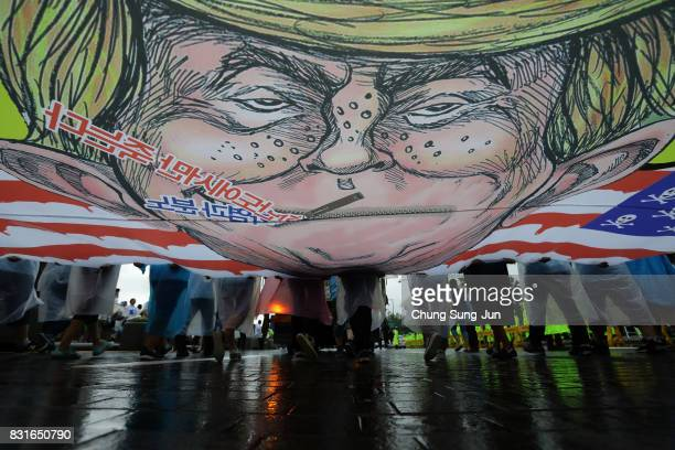 South Korea protesters hold placards with an illustration of US President Donald Trump during a during a 72nd Liberation Day rally on August 15 2017...