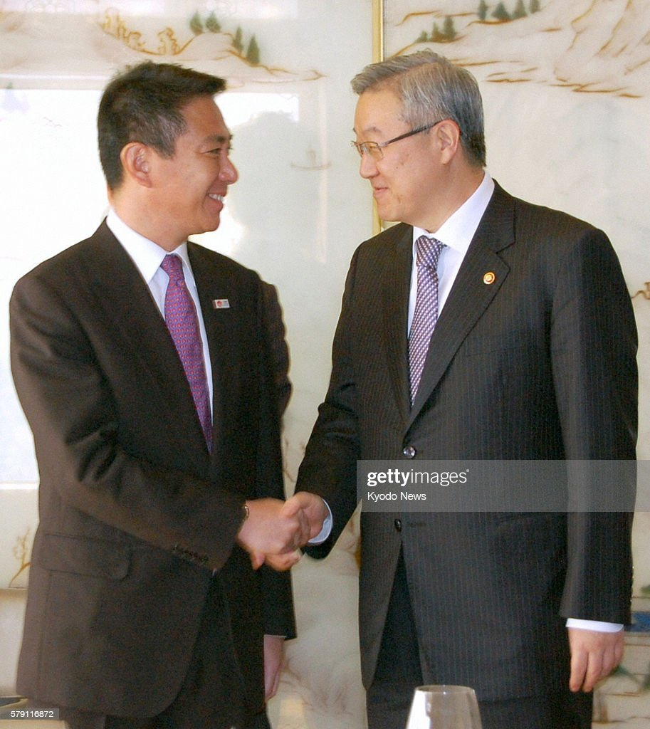 SEOUL South Korea Seiji Maehara policy chief of the ruling Democratic Party of Japan shakes hands with South Korean Foreign Affairs and Trade...