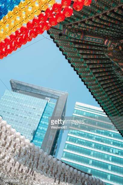 South Korea, Seoul, Lanterns in Jogyesa Temple and modern buildings in the background