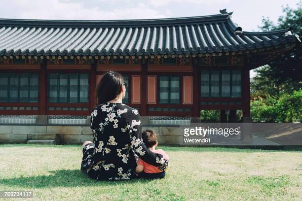 South Korea, Seoul, Mother and baby girl visiting Gyeongbokgung Palace