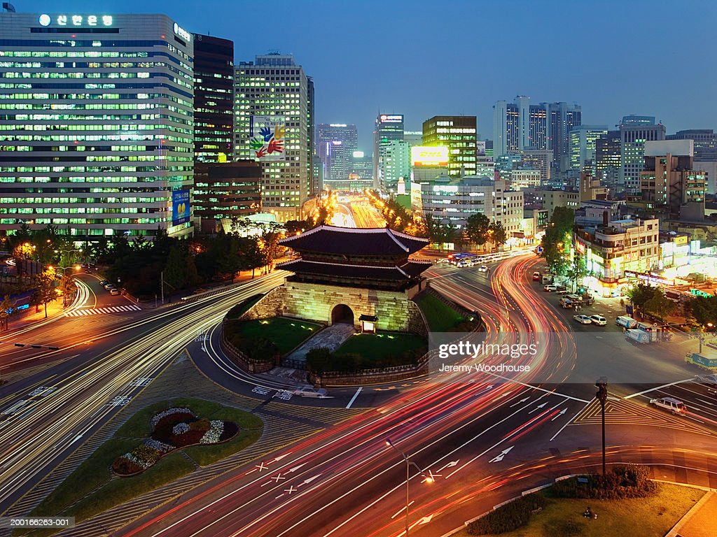 South Korea, Seoul, Namdaemun Gate and traffic, dusk, elevated view
