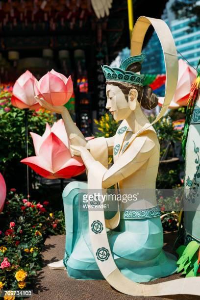 South Korea, Seoul, Woman with lotus lantern at Jogyesa Temple to celebrate Buddhas Birthday