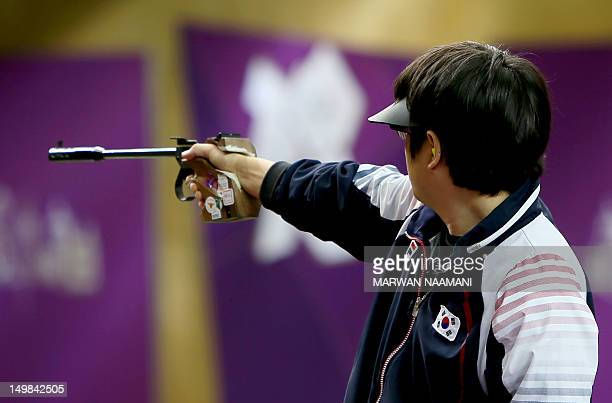 South Korea silver medalist Choi Young Rae competes in the London 2012 Olympic Games men's 50m pistol final at the Royal Artillery Barracks in London...