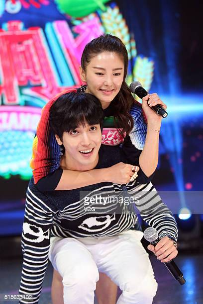 South Korea singer Jung Yong Hwa and Chinese actress Zhang Yuqi attend recording of 'Tian Tian Xiang Shang' as a guest with other celebrities on...