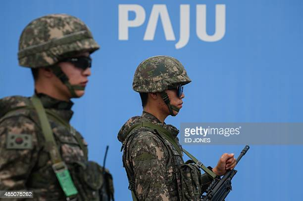 South Korea soldiers stand on the Unification Bridge that leads to the Demilitarized Zone between North and South Korea in Paju on August 24 2015...