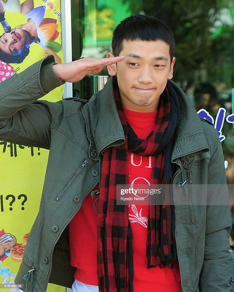 SEOUL South Korea South Korean pop singer and actor Rain gives a salute to his fans in Uijeongbu Gyeonggi Province South Korea on Oct 11 before...