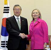 BUSAN South Korea US Secretary of State Hillary Clinton and South Korean Foreign Affairs and Trade Minister Kim Sung Hwan shake hands prior to...